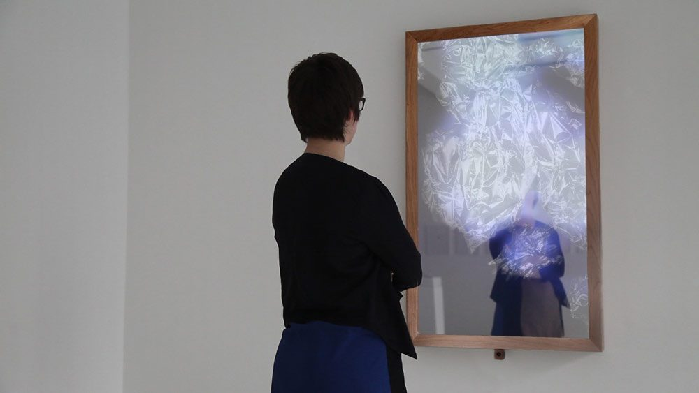 Transient Shade II (2017), interactive work with Liquid cristal display, sensor, glass, mirror film, cherry wood, 140 x 83 x 10cm